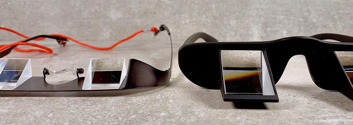 Die Brille links von Topside verdeckt quasi keinen Bereich im Sichtfeld des Sichernden, während die TooB-Sicherungsbrille mit dem dicken Kunststoff eigentlich nur den Blick durch die Prismen zuläßt.